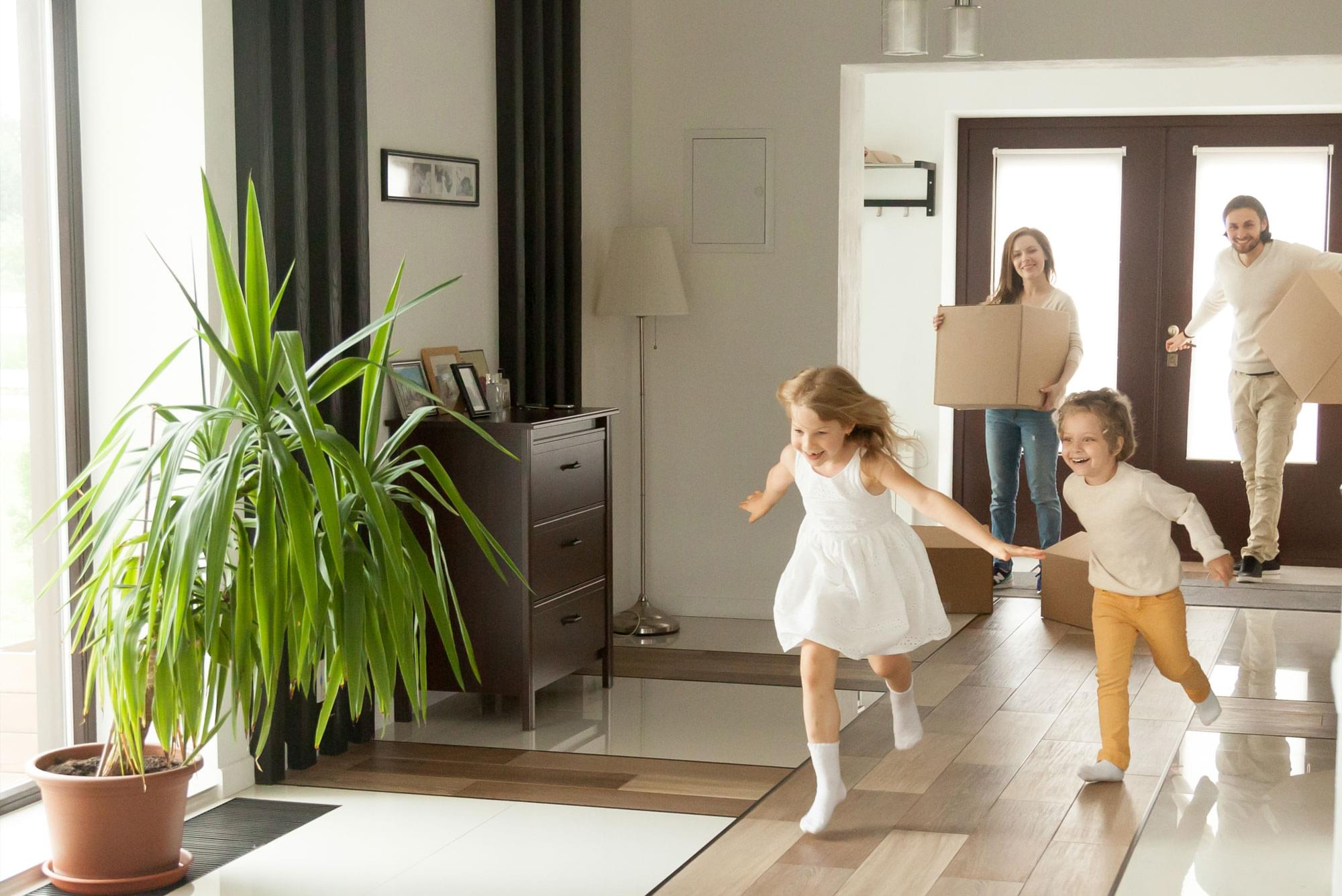Family running in new home
